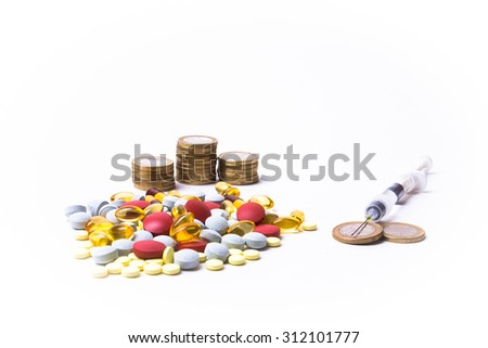Medicine pills or capsules with money and syringe on white background. Pharmacy business, drug cost. Cash currency, expensive bill. Finance concept of pharmaceutical medication. Euro coins. - stock photo
