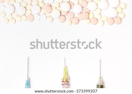 Medicine pills or capsules with syringe on white background. Drug prescription for treatment medication. Pharmaceutical medicament, cure in container for health. Antibiotic, painkiller closeup. - stock photo
