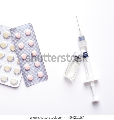 Medicine pills or capsules with syringe on white background. Drug prescription for treatment medication. Pharmaceutical medicament, cure in container for health. Injection with vaccine - stock photo