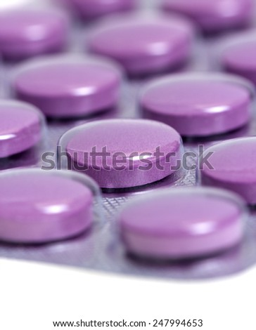 Medicine pills packed in blisters isolated on white background - stock photo