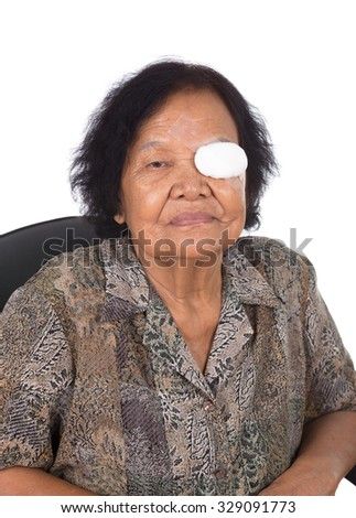 Medicine plaster patch on old woman injury wound eye on white background - stock photo
