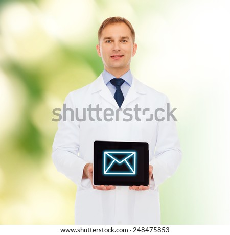 medicine, profession, and healthcare concept - smiling male doctor showing tablet pc computer screen over natural background - stock photo