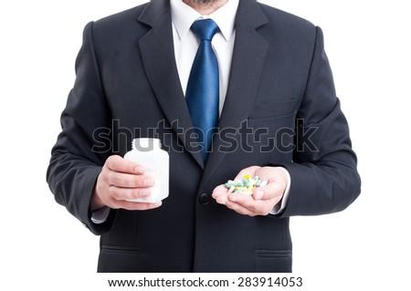 Medicine sales representative holding pills and bottle - stock photo