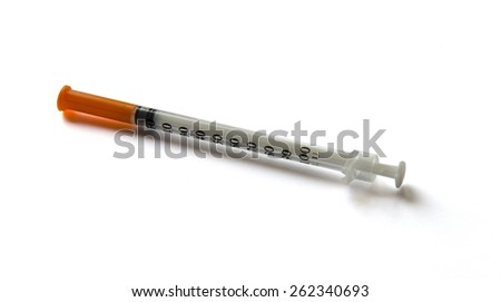 Medicine syringe on isolated white background - stock photo