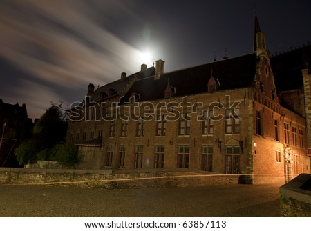 Medieval building in Bruges, Belgium, at night - stock photo
