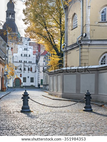Medieval buildings in the center of old Riga city. Riga is the capital and largest city of Latvia, a major commercial, cultural, historical and financial center of the Baltic region - stock photo
