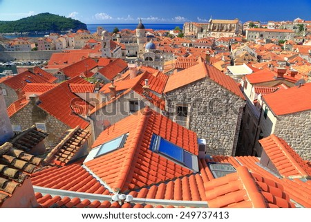 Medieval buildings with orange rooftops inside the old town of Dubrovnik, Croatia - stock photo