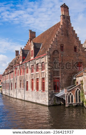 Medieval canal street in center of old town in Bruges, Belgium, West Flanders - stock photo