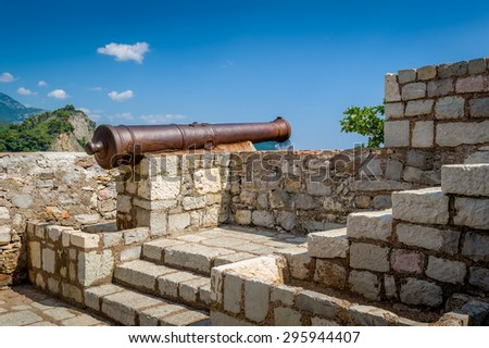 Medieval cannon gun on the walls of old Petrovac old town fortress. Montenegro - stock photo