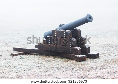Medieval cannon on a cold winter day - stock photo