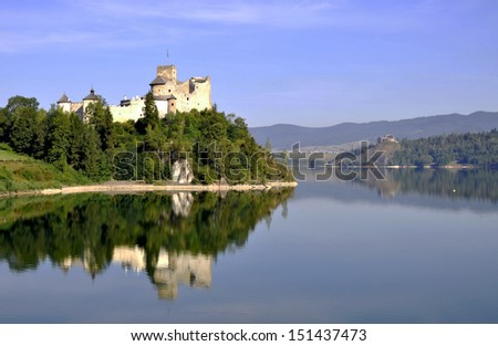 Medieval castle in Niedzica, Poland, built in 14th century, with artificial Czorsztyn lake on Dunajec river and the far view of Czorsztyn castle. - stock photo