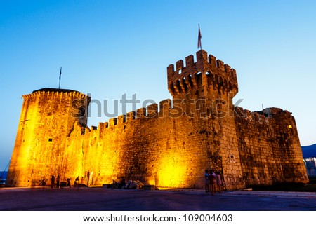 Medieval Castle of Kamerlengo in Trogir Illuminated in the Night, Croatia - stock photo