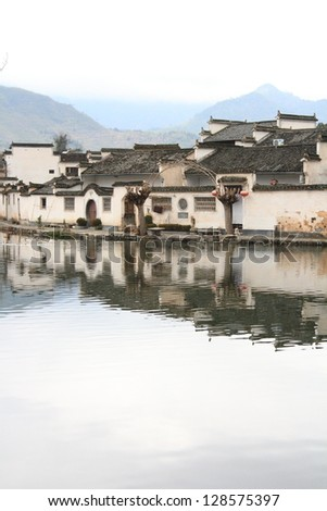 medieval Chinese village of Hongcun and reflection, a unesco world heritage site in China - stock photo