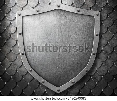 medieval coat of arms shield over metal scales background - stock photo