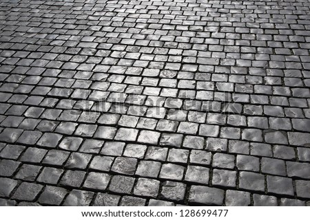 Medieval cobblestone pavement at streets of Vatican - stock photo