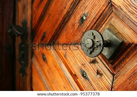 medieval door handle to lock in the background - stock photo