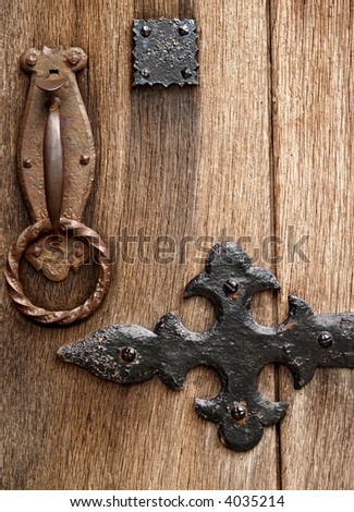 Medieval door latch and ironwork up close - stock photo