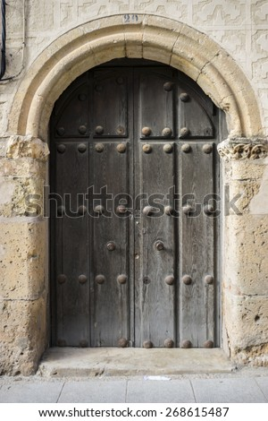 medieval door Spanish city of Segovia. Old wooden entrance. ancient architecture - stock photo