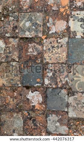 Medieval floor tile in situ - stock photo