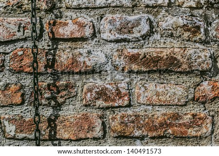 Medieval Fortress Antique Brick Wall With Chain - stock photo