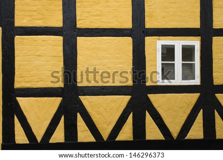 Medieval half-timbered and brick house in Ribe, Denmark. - stock photo