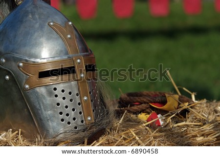 Medieval helmet and rope  (Close up of a medieval armour) - stock photo