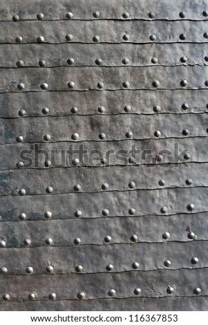 Medieval iron door texture as background - stock photo