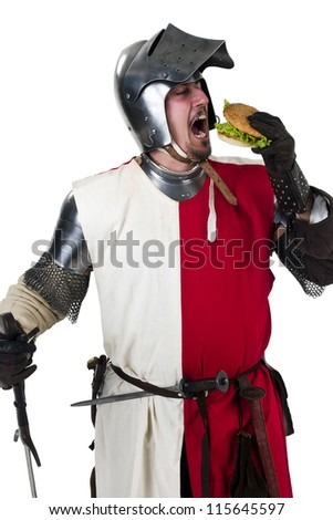 medieval knight eating a tasty hamburger - stock photo