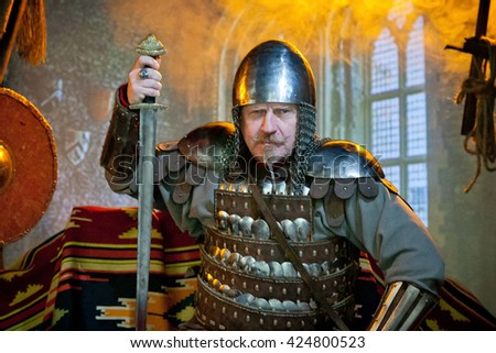 Medieval knight in iron armor - stock photo