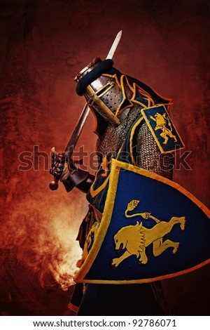 Medieval knight on abstract background. - stock photo