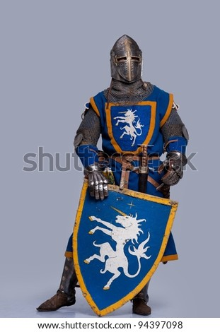 Medieval knight on grey background. - stock photo