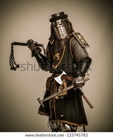 Medieval knight with different weapon - stock photo