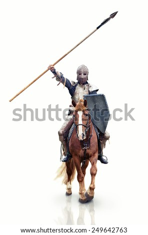 Medieval knight with the lance riding the horse. Focus point on the knight. - stock photo