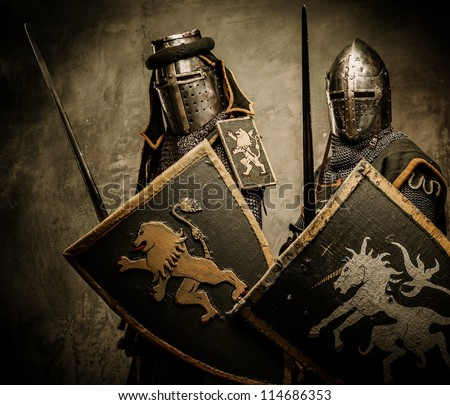 Medieval knights on grey background - stock photo