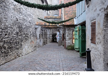 Medieval lane in the Old Town of Tallinn in Estonia in the snowless winter - stock photo