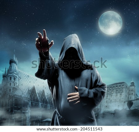 Medieval monk at night - stock photo