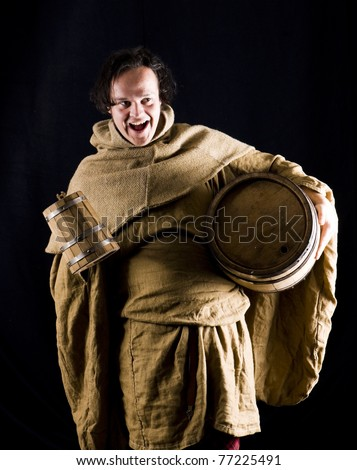 medieval monk with wine barrel - stock photo