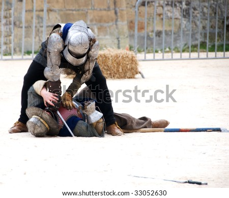 Medieval Re-enactment - two knights in battle - stock photo