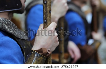 medieval reenactment with costumed characters and ancient clothes - stock photo