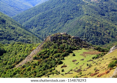 Medieval ruins of the fortress in Liteni, (Magyarleta), in Transylvania, Romania - stock photo