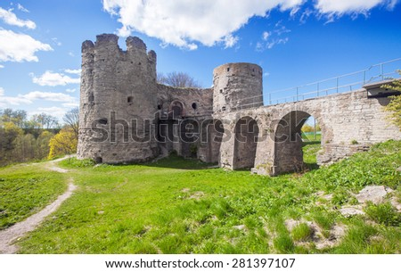 Medieval Russian Koporye fortress with two towers and bridge - stock photo