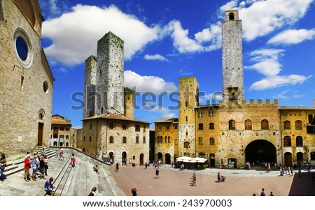 medieval San Gimignano, central square, Tuscany, Italy - stock photo
