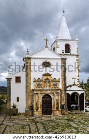 Medieval Santa Maria Church showing a Renaissance Portal. Obidos is a medieval town inside walls, and very popular among tourists. - stock photo