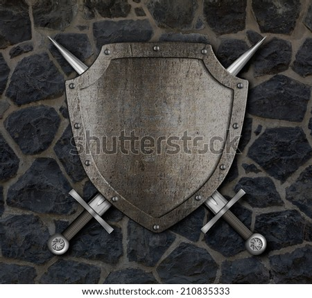 Medieval shield and crossed swords on stone wall - stock photo