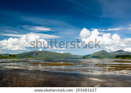 Medieval Stalker Castle on small island in amazing landscape in loch linnhe argyll in the scottish highlands - stock photo