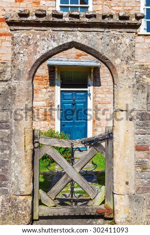 medieval stone garden door at Vicars Close in Wells, Somerset, England - stock photo