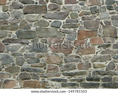 Medieval stone wall (background) - stock photo