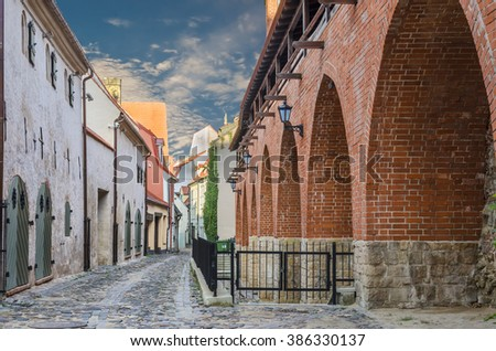 Medieval street in the old Riga city. Riga is the capital and largest city of Latvia, a major commercial, cultural, historical, tourist and financial center of the Baltic region  - stock photo