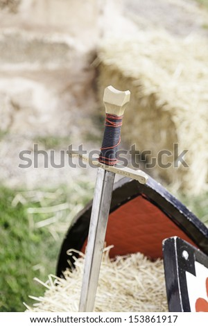 Medieval sword of war, ancient weapon detail of war, death and destruction, inquisition - stock photo