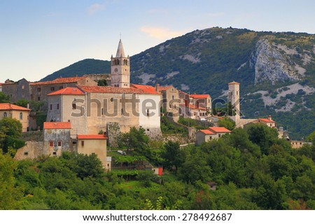 Medieval village with fortified walls and Romanesque architecture from the Adriatic sea area, Istria peninsula, Croatia - stock photo